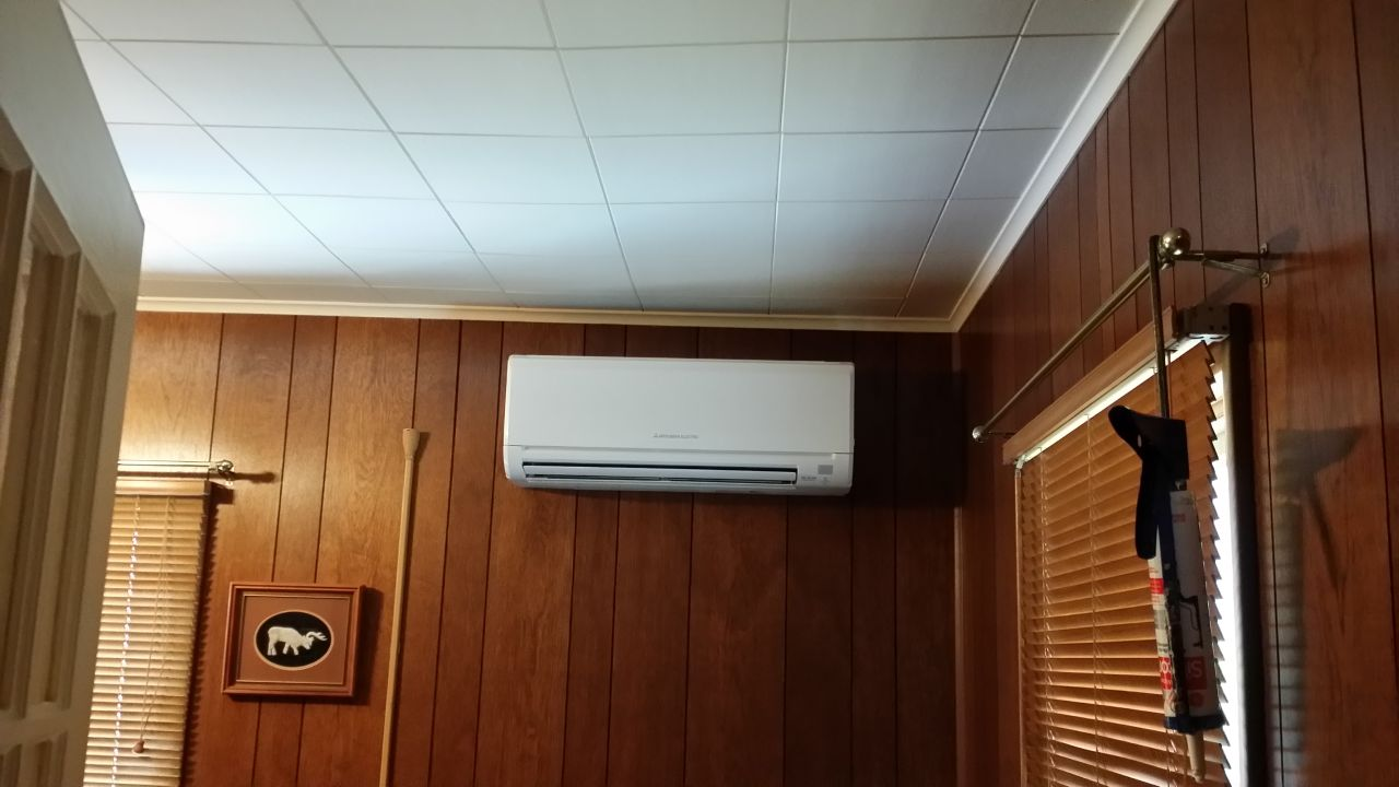 Indoor unit installed on wooden wall paneling in Brooklyn, NY