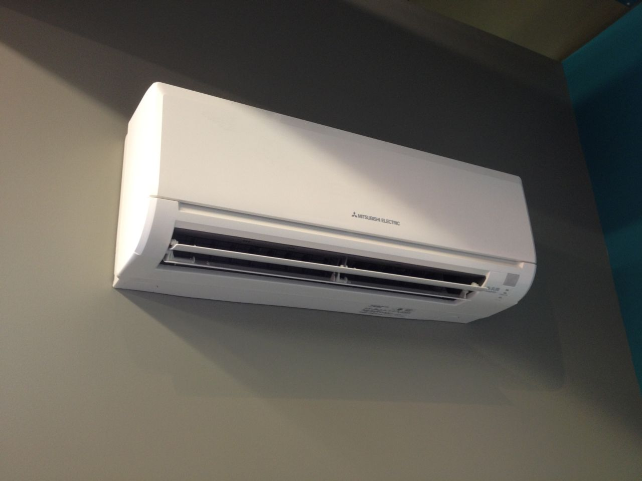 Mitsubishi indoor unit installed on wall in home in Queens, NY